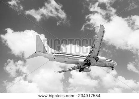 Philipsburg, St Maarten - February 13, 2016: Plane Fly High In Blue Sky In Philipsburg, St Maarten W