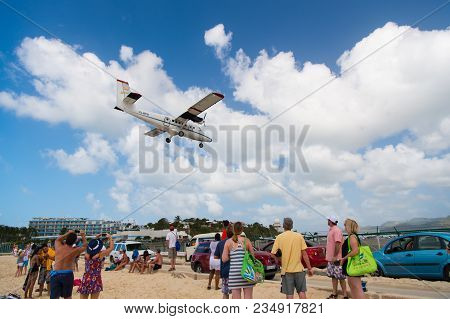 Philipsburg, Sint Maarten - February 13, 2016: Wanderlust, Travel And Trip. Plane Land Over Maho Bea