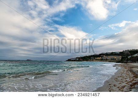 Sea Beach On Cloudy Sky In Philipsburg, Sint Maarten. Seascape With Town On Mountain Landscape, Natu