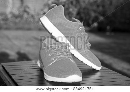 Sports Shoes Sneakers Bright Orange Color. Sports In The Open Air. Orange Sport Sneakers Modern Styl