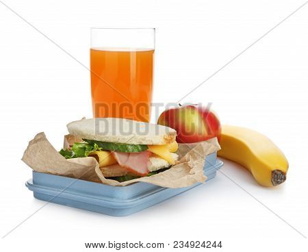 Lunch Box With Appetizing Food And Glass Of Juice On White Background