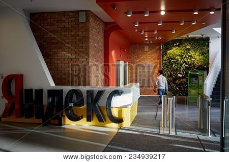 MOSCOW, RUSSIA - NOV 09, 2017: Logo of Yandex company and entry turnstiles, Morozov business centre. Yandex N.V. is a multinational corporation specializing in Internet-related services and products.