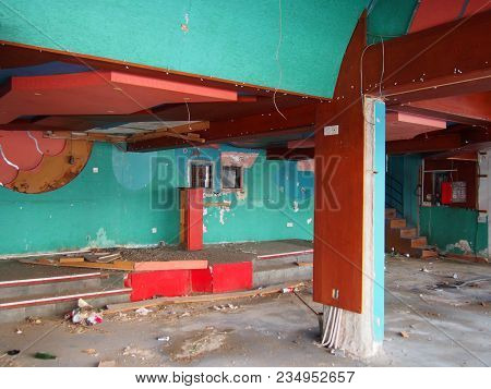The Interior Of A Derelict Abandoned Discotheque Or Nightclub With Rubble Covered Floor And Wired Ha