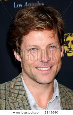 LOS ANGELES - SEP 17:  Jamie Bamber arrives at the 9th Annual BAFTA Los Angeles TV Tea Party. at L'Ermitage Beverly Hills Hotel on September 17, 2011 in Beverly Hills, CA