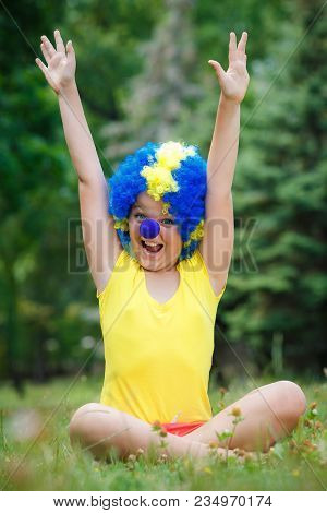 Child Kid Girl With Party Clown Blue Wig Funny Happy Open Arms Expression And Garlands In The Park