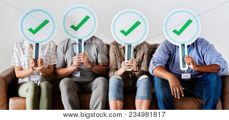 Group of people holding check icons