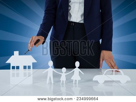 Cut outs of house family and car insurance with woman