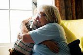 Grandma and grandson hugging together poster