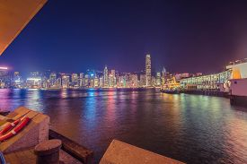 Hong Kong Skyline In The Evening Over Victoria Harbour.