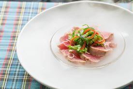 Top View Salmon Sashimi On Ice With Dry Ice Smoke, Japanese Food.