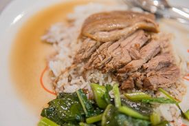 Stewed Pork Leg On Rice With Garlic And Kale In Top View.
