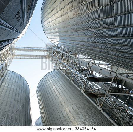 Modern Elevator For Storing Grain Against The Sky. Grain Drying Complex, Storage And Transportation