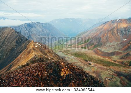 Vivid Multicolor Landscape Of Green Valley Among Big Rocky Mountains. Beautiful Highland Scenery Of