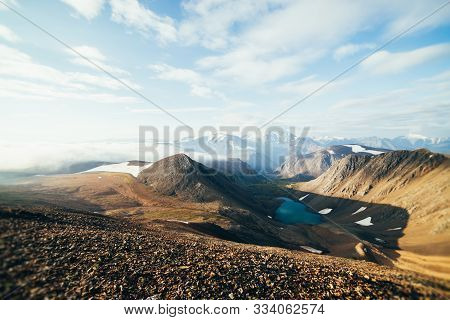 Beautiful Atmospheric Alpine Landscape With Snowy Mountains, Glaciers And Mountain Lake. Big Snowy M