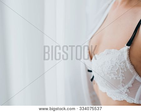 Elegant Women Underwear. Woman With Perfect Body In White Floral Lace Bra With Black Shoulder Strap.