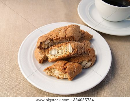 A Cup Of Coffee With Cantucci Biscuits. A Cup Of Coffee With A Traditional Tuscan Cantucci Biscuits.
