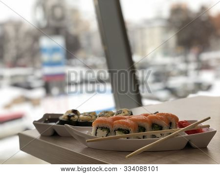 Luscious Sushi Philadelphia On A Table Overlooking The Winter Street, Working Atmosphere Next To The