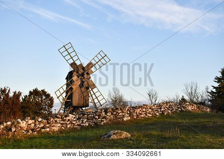 Old Dry Stone Wall And A Traditional Windmill By Fall Season At The Island Oland In Sweden