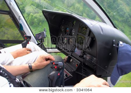 Pilots In Helicopter Cabin