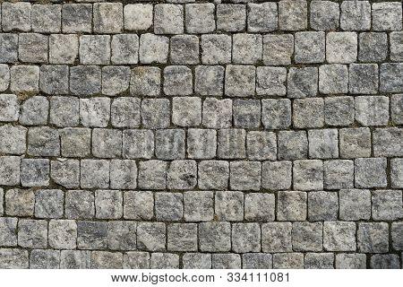 European Cobblestone Pavement Square. Gray Stone Background, Textured Pedestrian Pavement, Road In E