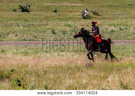 Dnipropetrovsk Region, Ukraine - June 2, 2018: Ukrainian Cossack Riding A Horse During Ethno-rock Fe