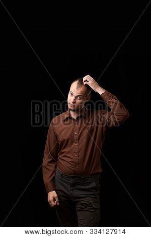 Portrait Of A Sympathetic Emotional Guy. Studio Portrait Of Young Handsome Sympathetic Man