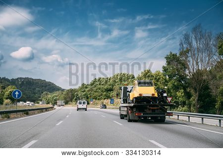 Car Service Transportation Concept. Tow Truck Transporting Retro Car On Motorway Freeway Highway. He