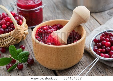 Wooden Bowl Of Crushed Cranberries, Basket Of Bog Berries, Jar Of Crushed Berries, Jam Or Sauce And