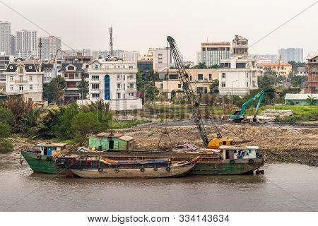 Ho Chi Minh City Vietnam - March 12, 2019: Song Sai Gon River. Closeup Of Barges With Cranes Adjacen