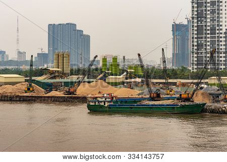 Ho Chi Minh City Vietnam - March 12, 2019: Song Sai Gon River. Green Barge And Many Cranes And Heaps