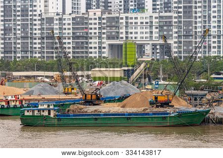 Ho Chi Minh City Vietnam - March 12, 2019: Song Sai Gon River. Closeup Of Green Barges And Many Cran
