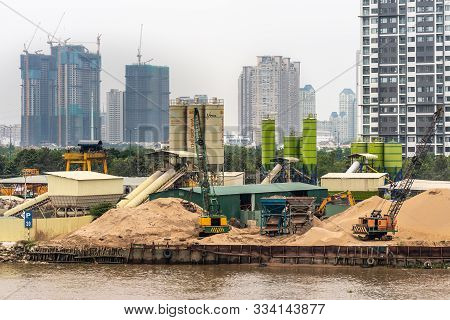 Ho Chi Minh City Vietnam - March 12, 2019: Song Sai Gon River. Closeup Of Silos, Cranes And Heaps Of