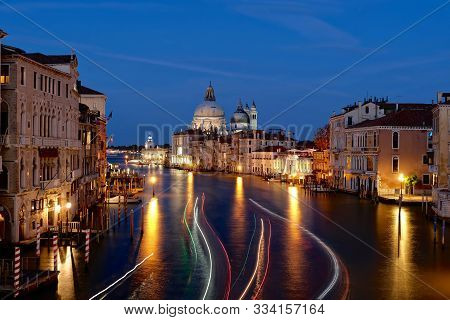 Accademia Bridge At Sunset. View From Accademia Bridge In Venice. Colorful Light Treks From Boats Li