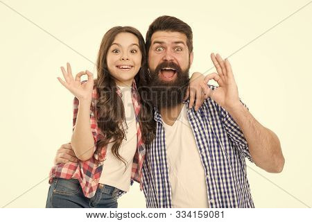 Casual And Informal. Bearded Man And Cute Girl In Casual Outfit Gesturing Ok. Happy Father And Small