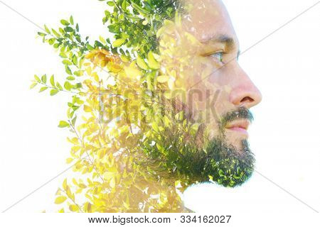 Double exposure close up profile portrait of an attractive man combined with plants, created with an ecological concept