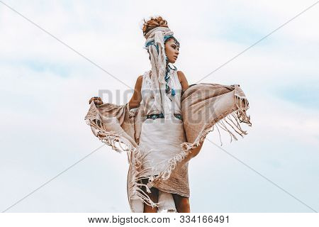 Young Tribal Style Woman With Lot Of Boho Accessories Outdoors