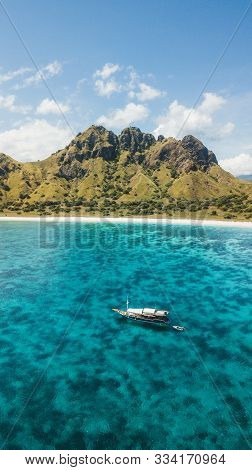 Luxury Cruise Boat Sailing Over Coral Reef With Amazing Tropical Beach And Mountain View. Aerial Vie