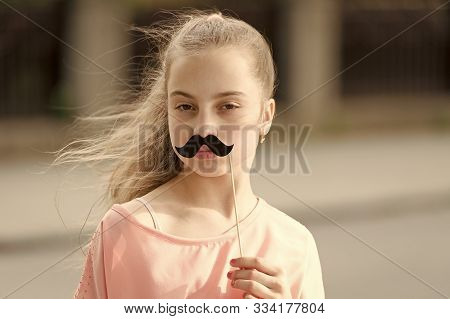 Loving Her Mustache. Little Girl With Fake Mustache. Cute Child Holding Mustache Props On Stick. Hav