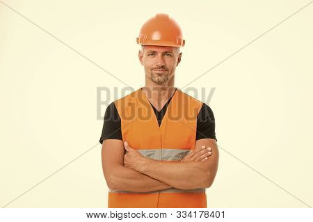 Safety Is Main Point. Man Protective Hard Hat And Uniform White Background. Worker Builder Confident