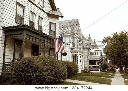 Burlington, Vermont - September 29th, 2019: Residential Street With Row Of White Wooden Houses In Th