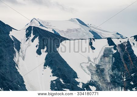 Atmospheric Alpine Minimalist Landscape With Giant Mountain Range And Massive Glacier. Wonderful Mou