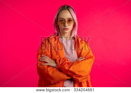 Portrait Of Odd Hipster Girl With Pink Hairstyle Isolated In Studio. Trendy Woman With Nose Piercing