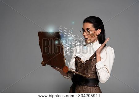 Shocked Steampunk Woman In Glasses Using Vintage Laptop With Glowing Digital Illustration Isolated O