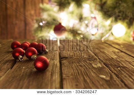 Goup Of Colorful Christmas Baubles On Wooden Table. Christmas Decorations On Wooden Surface