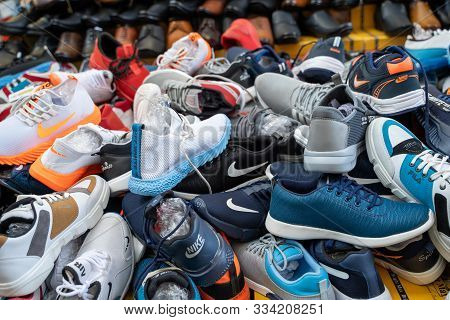 New Delhi, India - November 17, 2019: Piles Of Mens Knock Off Designer Tennis Shoes For Sale In Nehr