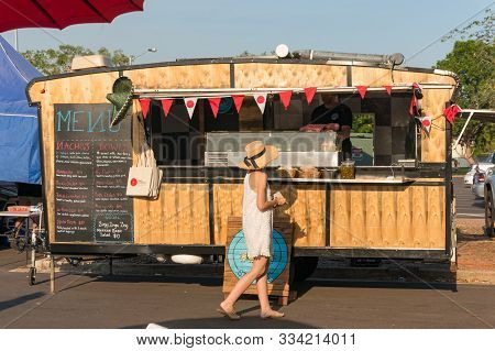 Darwin, Australia - June 1, 2019: Woman Buying Mexican Food From Street Food Wagon On Malak Farmers