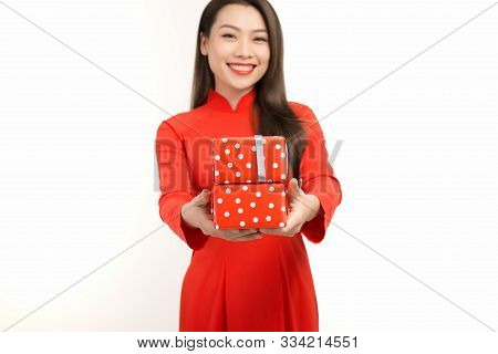 Asian girl in ao dai, concept celebrating Lunar New Year or spring festival, isolated on white background. poster
