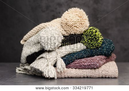 A Stack Of Folded Knitted Winter Scarves And Hats. Season Of Warm Clothes. Time To Keep Warm. Closeu