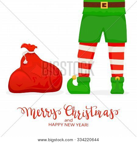 Elf Legs And Red Sack With Christmas Gift Boxes. Lettering Merry Christmas And Happy New Year On Whi