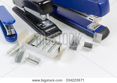 Expendable Metal Staples To The Paper Staplers In Small Box And Beside Against Several Different Sta